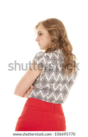 A woman with her arms folded and with an unhappy expression on her face. - stock photo