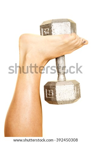 A woman with her feet up, holding on to a weight. - stock photo