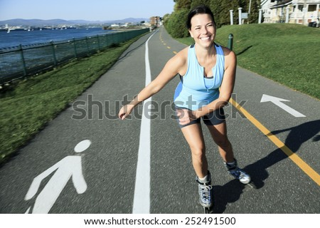 A woman with is rollerblade in summer time - stock photo