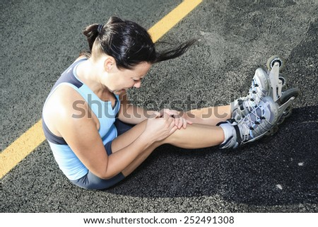 A woman with is skating in summer time - stock photo