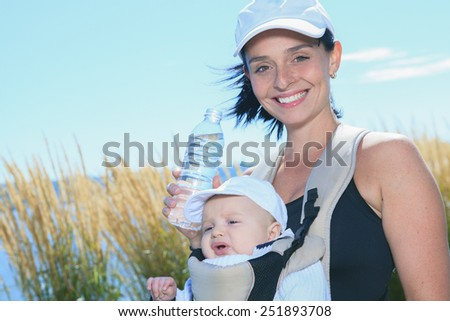 A Woman with little boy running outside - stock photo