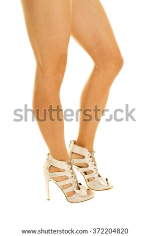 a woman with long legs in her heels with her knee out. - stock photo