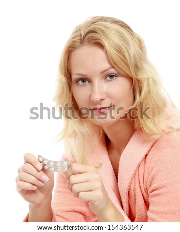 A woman with pills, isolated on white
