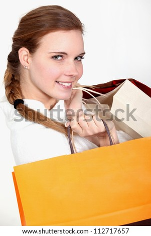 A woman with plenty of shopping bags.