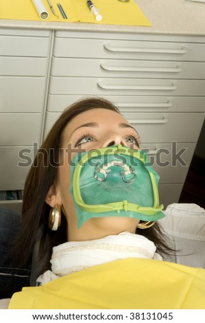 A woman with the dentist