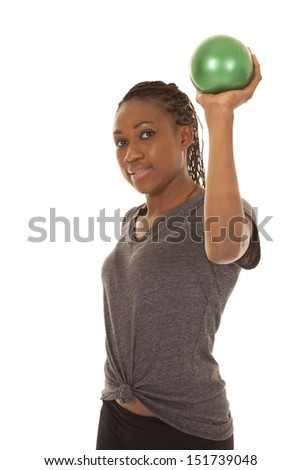 a woman working out with her weighted green balls .