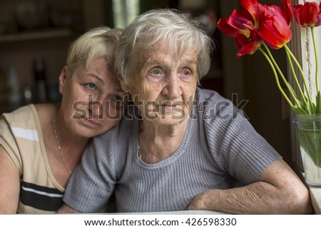 A woman 80 years old with his adult daughter. - stock photo
