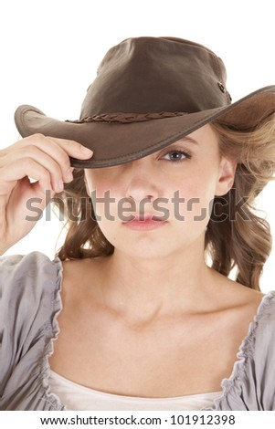 A womans head with a cowboy hat on. - stock photo