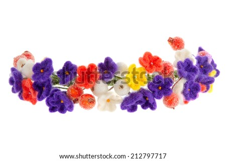 a women's jewelry wreath on head of flowers and berries