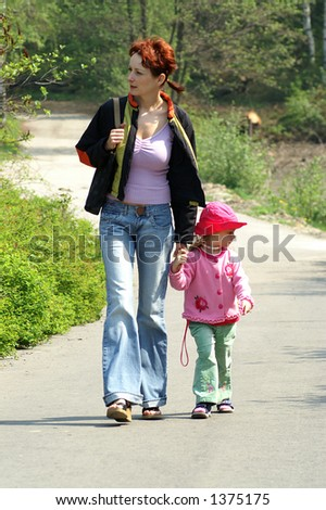 A women walking with her daughter