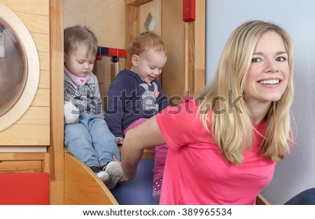 A Women with kids in indoor playground - stock photo