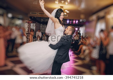 a wonderful pair of dancing at your wedding in a restaurant - stock photo
