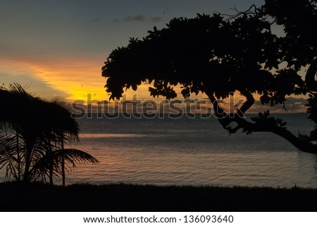 A wonderful sunset in tropical paradise sand beach