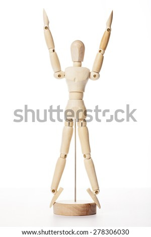 A wood doll's arms go up and legs spread like gold ratio isolated white background in the studio.