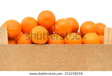 A wood rustic crate full of Clementine Mandarin Oranges.  - stock photo