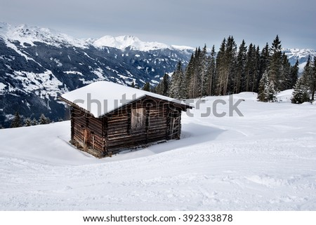 A wooden barn on the snowy slopes of the Karspitz Mountain, Zillertal, Austria - stock photo