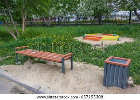 A wooden bench in the park a summer sunny day