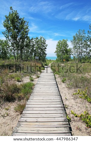 A wooden boardwalk leading to the Port Burwell beach, Elgin County, Ontario, Canada