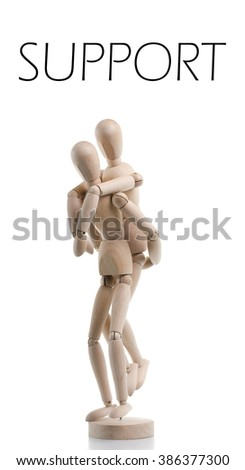 A wooden character supporting or carrying somebody on their back. - stock photo