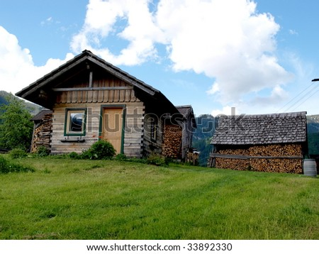A wooden cottage on the lawn. Beautiful landscape in Hallstatt town of  Austria. - stock photo