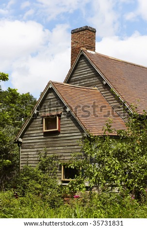 a wooden cottage with a back garden