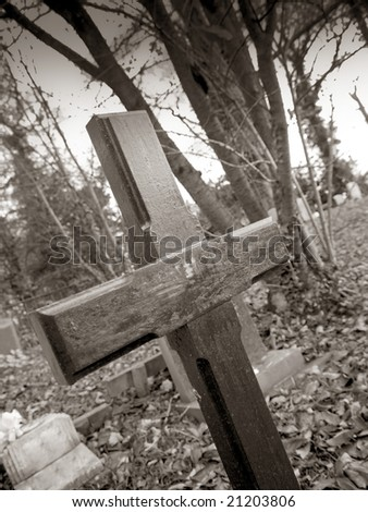 a wooden cross in a cemetery