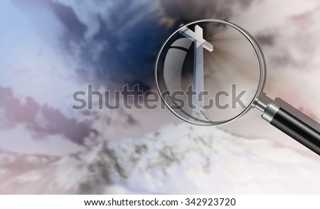 A wooden cross on a hill at sunset - stock photo