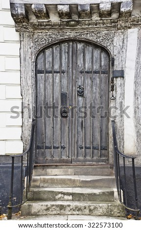 A wooden door in an old english house - stock photo
