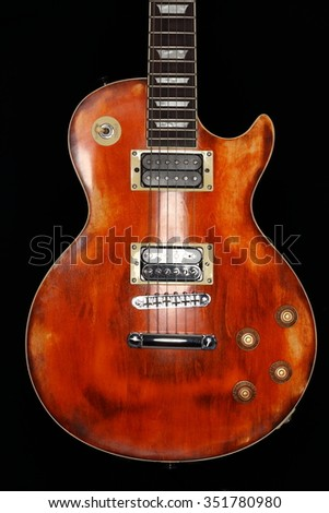 a wooden electric guitar with black background - stock photo
