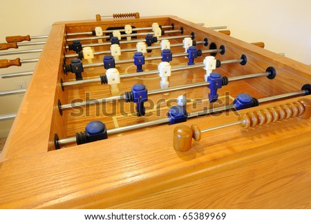 A wooden foosball table close up. - stock photo