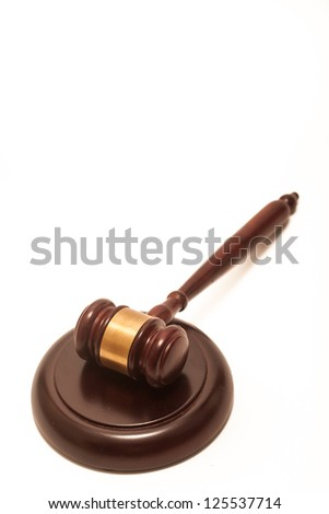 A wooden gavel and soundboard, isolated on a white background.