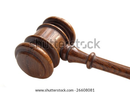 A wooden gavel in a studio shot, isolated on white. - stock photo