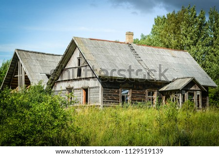 A wooden house in the countryside is abandoned