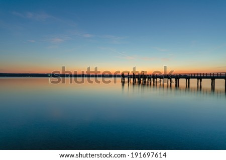 A wooden jetty photographed at Breitenbrunn at lake Ammersee in Upper Bavaria.