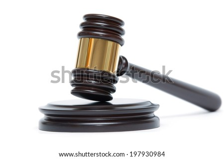 A wooden judge gavel and soundboard isolated on white background - stock photo