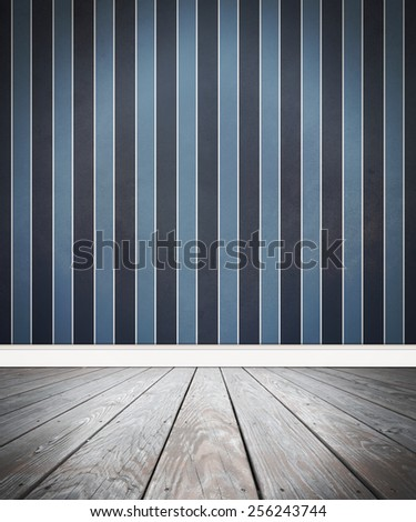 A wooden old floor with a blue stripped wall background. Add your own text message or subject to the empty area. - stock photo