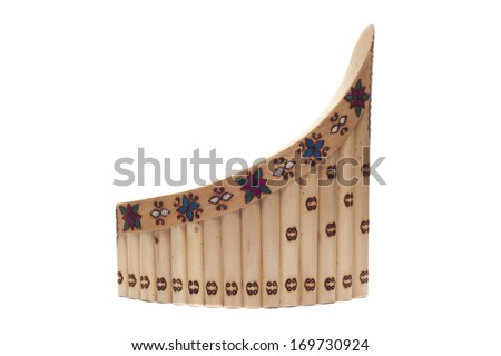 a wooden pan flute isolated over a white background - stock photo