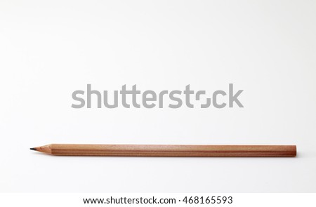 A wooden pencil isolated on a white background