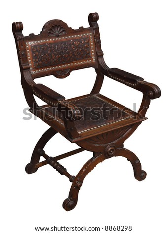 A wooden Renaissance armchair. Isolated.