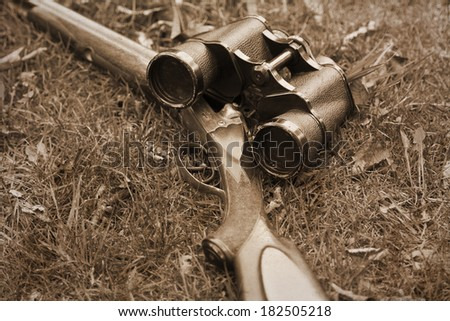 A wooden retro shotgun with binocular , sepia retro image style  - stock photo