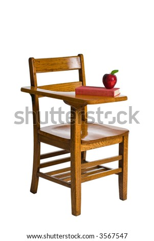 A wooden school desk with a red book and an apple. Isolated on white.