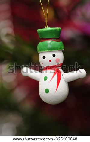 A wooden snowman  to decorate a christmas tree  - stock photo