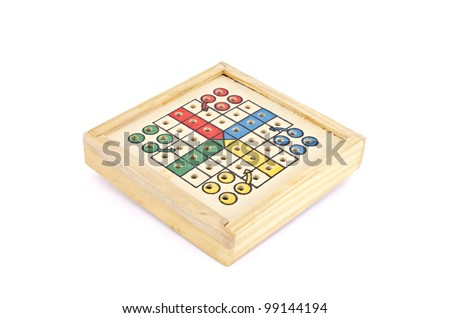 a wooden travel parchis - stock photo