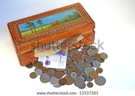 A wooden treasure chest with money