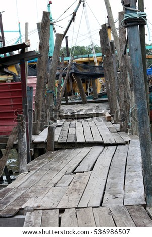 A wooden walk path alley on a towards deck a Boat fishing