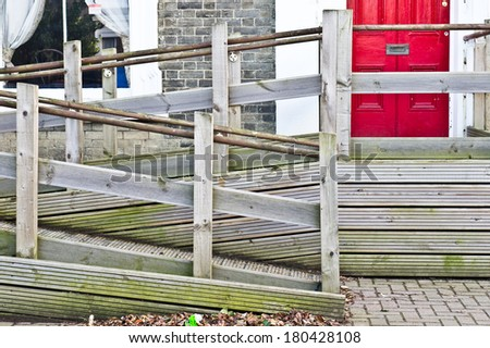 A wooden wheelchair ramp outside a building in England - stock photo