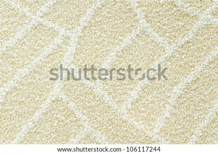 a woolen beige carpet with a relief pattern - stock photo