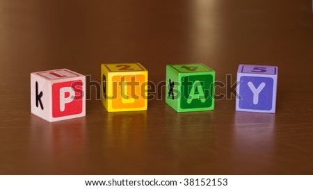 """A word """"play"""" written with wooden blocks - stock photo"""