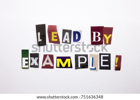 A word writing text showing concept of Lead By Example made of different magazine newspaper letter for Business case on the white background with space