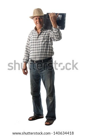 a worker carries a plastic box - stock photo